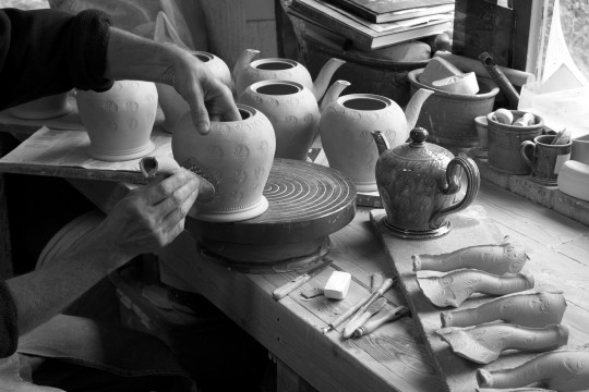 A&J Young Pottery - applying moulded spouts to teapots