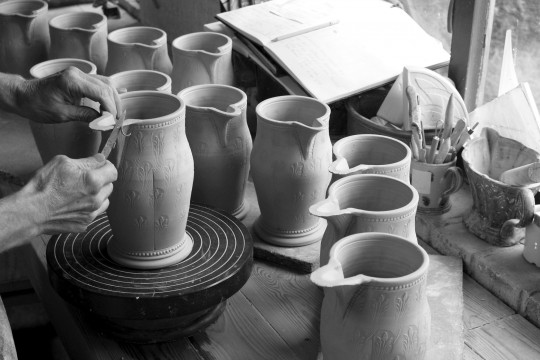 A&J Young Pottery - detail-trimming-spouts-on-large-jugs