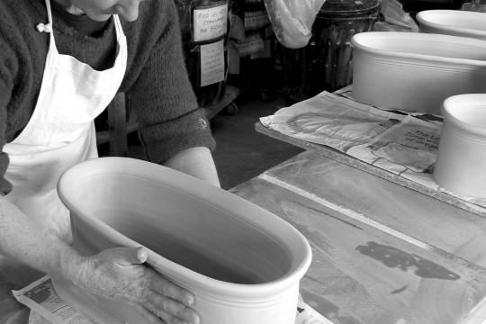 A&J Young Pottery - shaping trough onto new base