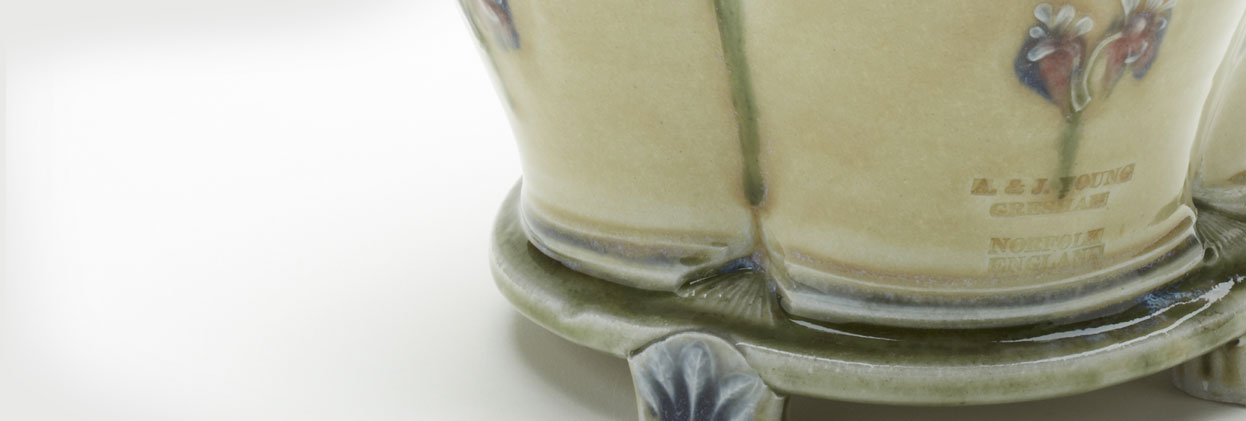 A&J Young pottery - fluted pot with feet